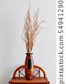 Dry flower arrangement in wooden vase 54941290