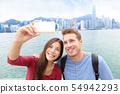 Selfie - friends taking picture in Hong Kong 54942293