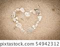 Shells on the ocean beach, heart shape background 54942312