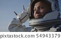 Astronaut opening helmet 54943379