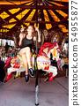 Girl having fun in amusement park 54955877