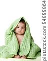 Cute baby sitting between green blanket. 54955964