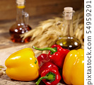 sweet peppers, wooden table background 54959291