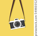 hanging vintage camera with strap on yellow 54960352