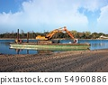 Excavator for channel dredge on a barge. 54960886