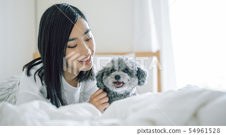 Life with a dog Woman 54961528