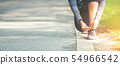 Running woman tying laces of running shoes 54966542
