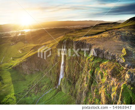 Dramatic top view of waterfall peak, Iceland 54968947