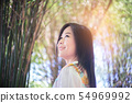 Freedom woman enjoying the fresh air in green 54969992