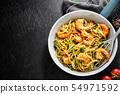 Spaghetti pasta with pesto and shrimps 54971592