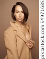 Fashion beautiful lady in beige coat 54971685