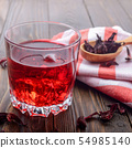 Closeup view at glass of tea with ice and spoon of 54985140
