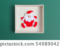 Small Santa Claus in a Christmas Day Gift Box 54989042