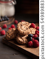 Delicious chocolate cookies for breakfast with milk and blueberries 54989883