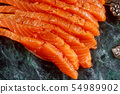 Sliced fresh salmon on marble board 54989902