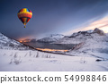 Hot air balloon flying on snow hill with fordgard 54998846