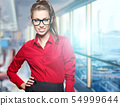 A portrait of a young business woman in an office 54999644