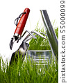 Garden tools and watering can with grass on white 55000099
