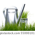 Garden tools and watering can with grass on white 55000101