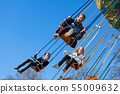 Teenage girls on the chain swing carousel 55009632