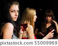 Three young women in a night bar 55009969