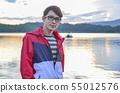 An Asian young man relaxing near the lake 55012576