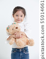 Portrait of little Asian girl hugging teddy bear 55014661