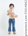 Portrait of little Asian girl hugging teddy bear 55014662