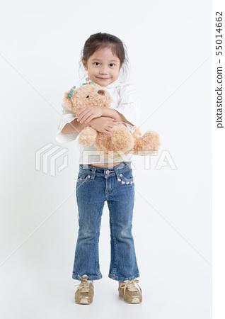 Portrait of little Asian girl hugging teddy bear 55014662