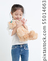Portrait of little Asian girl hugging teddy bear 55014663
