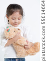 Portrait of little Asian girl hugging teddy bear 55014664