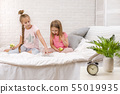 two little kids girls play in the bedroom 55019935