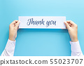 woman hand holding card with the word thank you 55023707