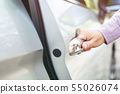 Close up image of a businessman hand on handle  55026074