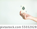 A hand showing Ace of spades on white background. 55032028
