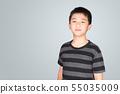 Studio portrait of happy Asian Thai boy smiling on 55035009