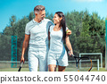 Handsome husband hugging wife after successfully playing tennis 55044740