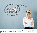 Dreaming of new home with young woman 55050410