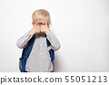 Portrait of a blond boy in glasses and with a 55051213