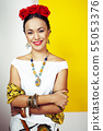 young pretty mexican woman smiling happy on yellow background, lifestyle people concept 55053376