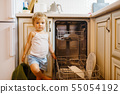 Little girl washing dishes on the kitchen 55054192