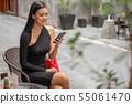 Beautiful young asian woman in black dress sitting 55061470