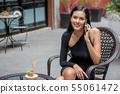 Beautiful young asian woman in black dress sitting 55061472