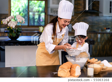 Happy asian family in the kitchen.Mother and son h 55063168