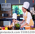 Happy asian family in the kitchen.Mother and son h 55063209
