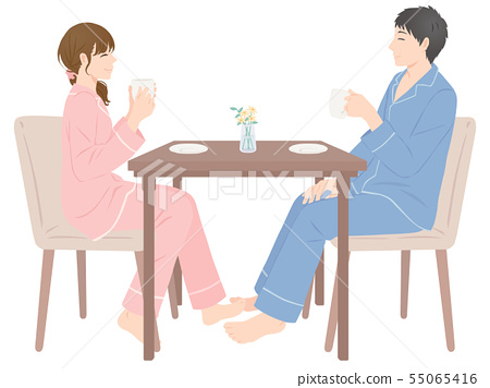 Couple drinking tea at a table 55065416