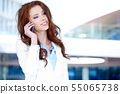 Pretty young business woman  using mobile phone 55065738