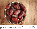 close up picture of dates palm fruit in cup  55070450