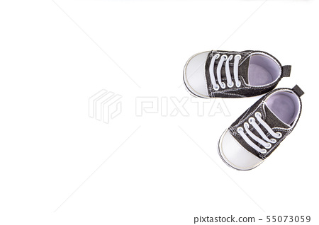 Baby shoes on white background. Selective focus 55073059
