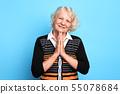 Senior happy blonde woman pressing palms together, praying the God 55078684